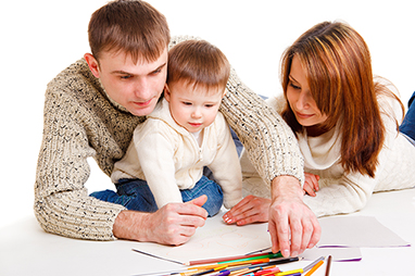 parents with child drawing